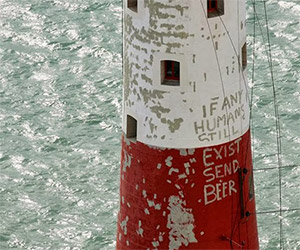 Post-Apocalyptic Cry For Help Painted on Lighthouse